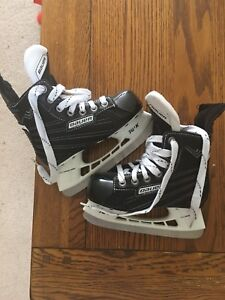 Bauer size 11 children's hockey skates.