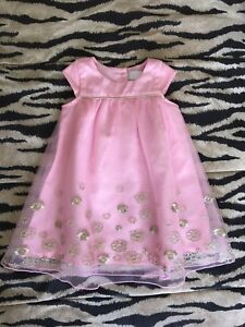 Baby's pink and gold holiday dress