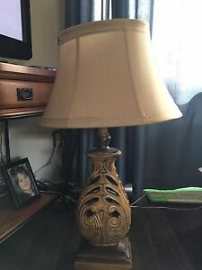 Two carved wood lamps.