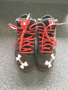 Youth size 1 Underarmour cleats.