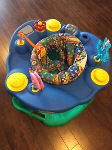 Baby exersaucer, walker and chair - $30 for lot