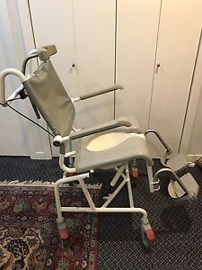 Tilting/rolling commode shower chair