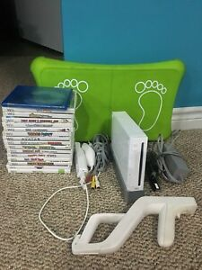 Nintendo Wii with over 20 games.