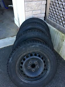 Bridgestone Blizzack 195 65 R15 winter tires.