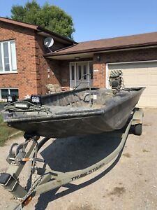 1654 Tracker grizzly with 23hp mud buddy surface drive