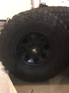 """Pro comp 17"""" rims and 35"""" goodyear mtrs for ram 2500"""