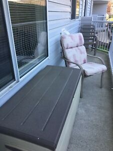 Four garden chairs with cushions and storage box