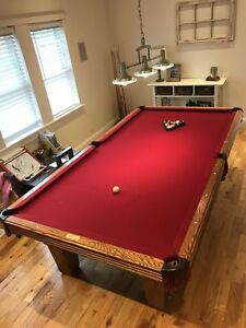 Mint condition 5 foot by 9 good pool table