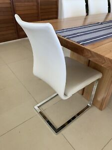 White leather dining chairs, high back, comfortable