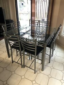 Bar height glass table - 8 chairs - great condition