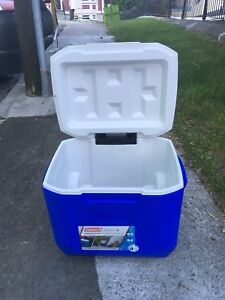Coleman wheeled 60 quart cooler, with retractable pull handle.