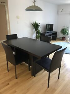 Dining room set—table and four leather chairs.