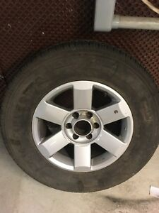 Spare tire on rim never used. P265/70P 18
