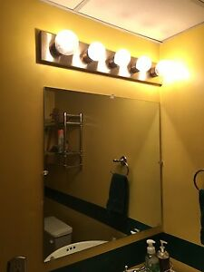 Mirror and light fixture
