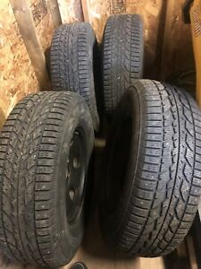 265/70R17 Winter Firestone Studded Tires on Black Steel wheels