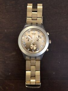 Swatch watch - Gold colour
