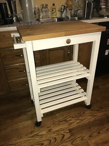 "Rolling kitchen stand with butcher block top 36"" tall"
