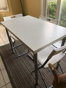 Ikea white wooden table with three chairs