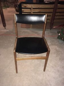 Wooden chair with black leather