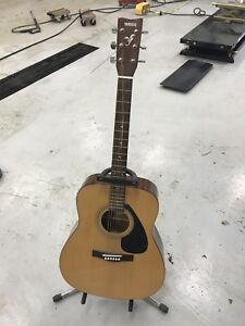 Yamaha F-310 Acoustic Guitar with Free Stand!