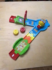 "Vtech Tut Tut Bolides ""Press n Go""."