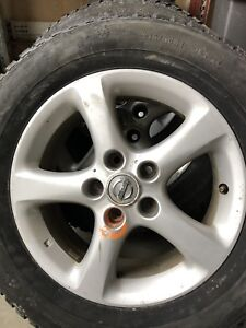 """4 Nissan 16"""" rims and snow tires"""