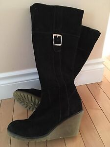 Black suede boots with a wedge