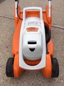 Stihl Lithium Ion Battery Lawn Mower and Stihl Grass Cutter
