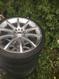 "Multi 5 bolt 18"" rims and tires"