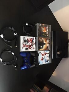 PS3 console with 4 games & 2 wireless controllers/150$ OBO