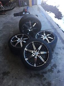 2 sets of tires and rims