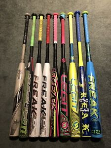 Various new and used softball bats