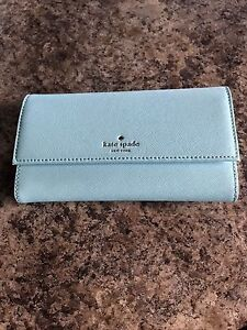 Brand new Kate Spade wallet with magnet iPhone 6 case