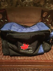 Insulated duffel bag with wheels
