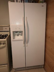 Fridge with water and ice dispenser.