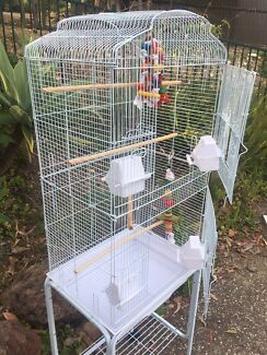 NEW - tall bird cage & trolley with shelf $95
