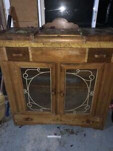 Antique hutch with drawers and upper storage