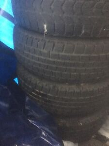 USED 4 WINTER  TIRES ON RIMS ( size 205/70 R15)
