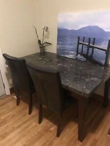 Black stone dining table with 4 leather chairs