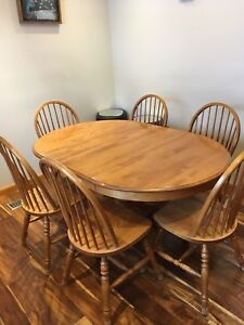 Oak Table with Six mataching chairs.  In good condition.  $200
