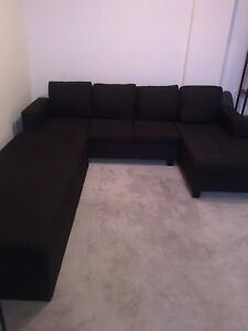 Black sectional with ottoman