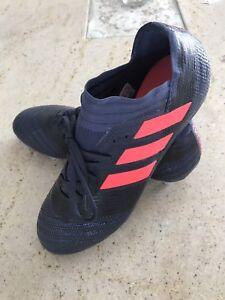 Unisex adidas Nemeziz soccer shoes.