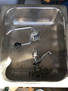 used rv sink with hand pump faucet and a regular faucet