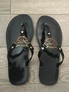 Previously loved black MK jelly sandals