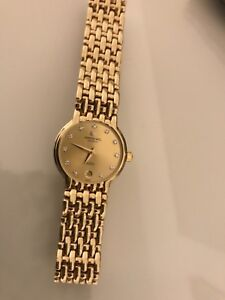 RAYMOND WEIL watch 18 K Gold plated and Real diamonds