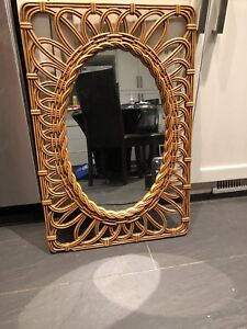 Oval shaped mirror with wooden frame $15