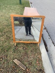 Three drawer dresser with a mirror