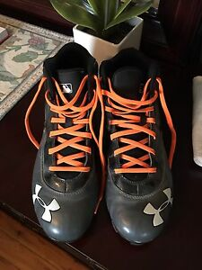 Men's Under Armour baseball cleats, size 9