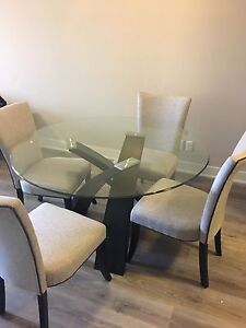 Grey chairs Round Glass Dining room table