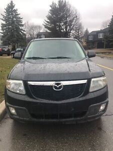 2009 Mazda Tribute...102 kms, 4-cyl, auto, equippee